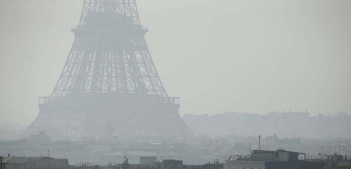 "TOPSHOTS A view of the Eiffel Tower seen through thick smog, on March 14, 2014, in Paris. Fine particle pollution in several French cities continued unabated today as the modest measures taken by local authorities failed to solve the underlying problem. French non-governmental organization (NGO) Ecologie Sans Frontiere (Ecology without borders) confirmed on March 11 that they had filed a criminal complaint in Paris to denounce the ""health scandal"" of air pollution, as several regions of France experienced high levels of particulate pollution. AFP PHOTO / PATRICK KOVARIK"