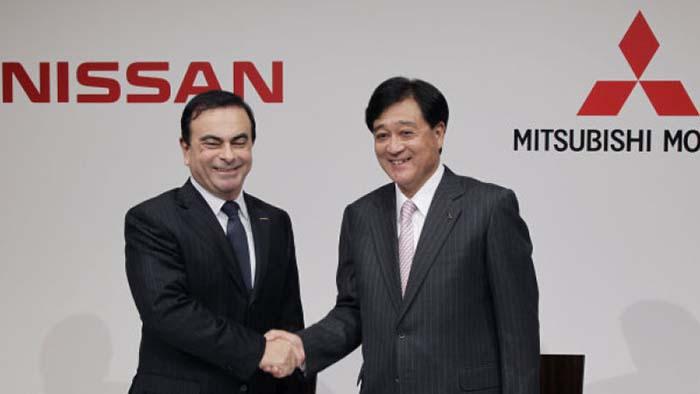 Carlos Ghosn y Osamu Masuko Nissan PHEV y Mitsubishi eléctricos