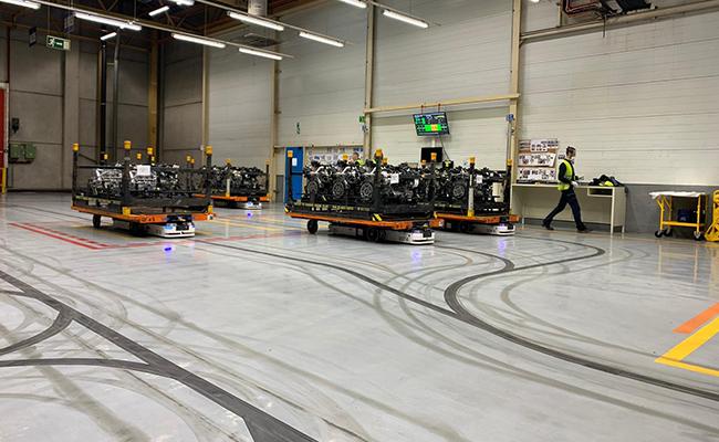 Actualmente, en las instalaciones de Ford se emplean vehículos guiados de manera automática (AGV) por líneas magnéticas.